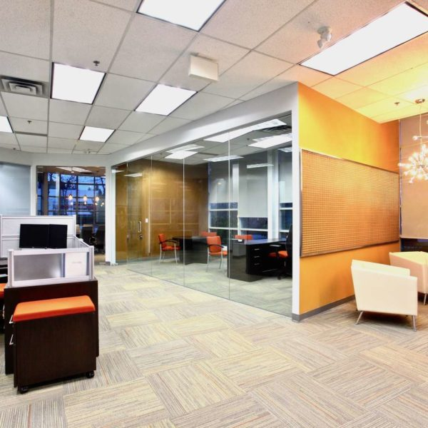 Modern office interior with glass partition, reception area with sputnik chandeliers,