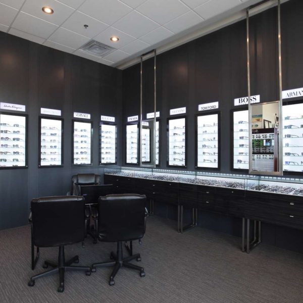 Optical store featuring built-in lighted cases for glasses.