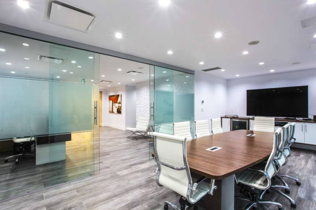 Modern corporate office boardroom with sliding glass door system.