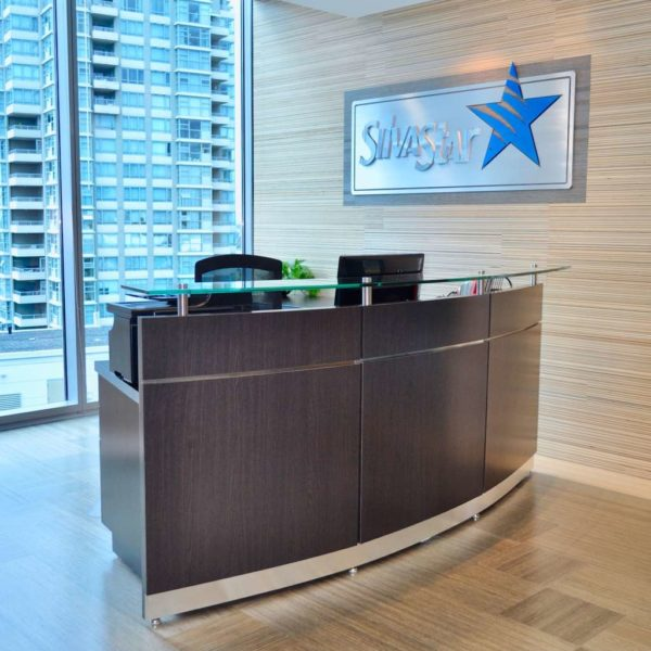 Custom reception desk in a modern corporate office in Vancouver.