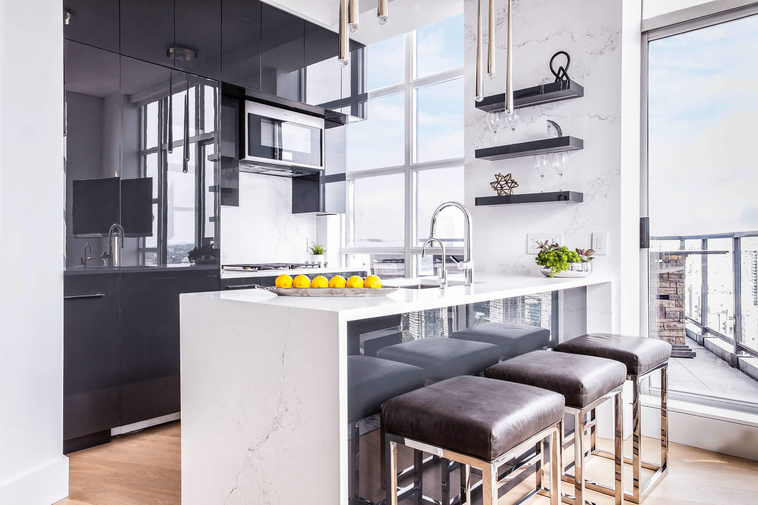 Modern flat panel kitchen with grey acrylic cabinets and white marble countertops.